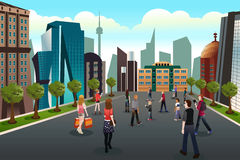 People walking outside toward high rise buildings Stock Photo