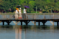 People Walking Over A Wooden Brigde Stock Photography