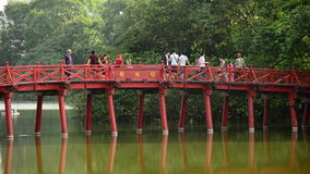 People Walking over The Huc Bridge on Hoan Kiem Lake - Hanoi Vietnam stock video footage