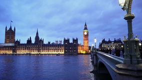 People walking over Westminster Bridge in beautiful London. LONDON, ENGLAND stock video