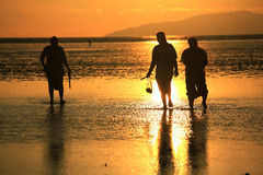 People walking on Pakmeng beach under sunset Stock Photo