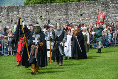 People walking during a parade of medieval characters Stock Photos