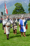 People walking during a parade of medieval characters Royalty Free Stock Photo