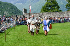 People walking during a parade of medieval characters Royalty Free Stock Photography