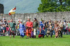 People walking during a parade of medieval characters Royalty Free Stock Photos