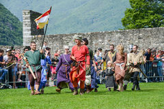 People walking during a parade of medieval characters Stock Photography