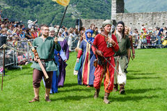 People walking during a parade of medieval characters Stock Images