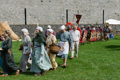 People walking during a parade of medieval characters Stock Image