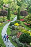 People walking through park in Butchart Gardens, Victoria, BC Stock Photography