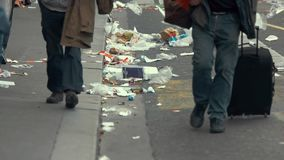 People walking past garbage. Trash on city road. Danger under our feet. Every deed impacts life stock video
