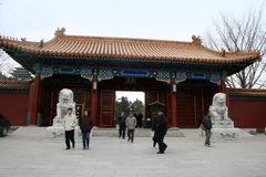 People walking past the lions at the entry gate to Jingshan Park Royalty Free Stock Images