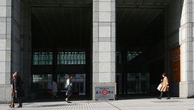 People walking past the United Nations University, Tokyo Royalty Free Stock Photo