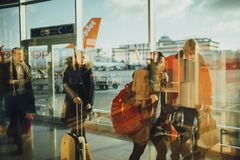 People Walking on Path Through Glass Walls at Daytime Royalty Free Stock Image