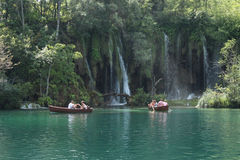 People walking on a path in Plitvice National Park Stock Photos