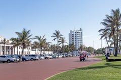 People Walking on Paved Promenade on Beachfront