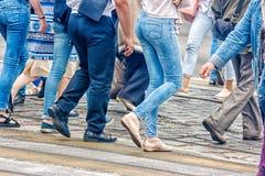 People walking on a pedestrian crossing stock image