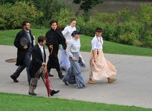 People Walking in Period Costumes Stock Image