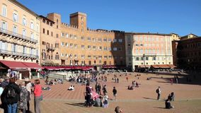 People walking in the Piazza del Campo, Siena, Italy stock video footage