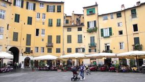 People walking in the Piazza Napoleone square, Lucca, Italy stock footage
