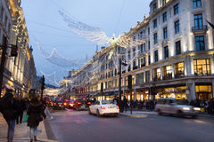 People walking in the Piccadilly Circus and Regent street during Christmas time Stock Photography