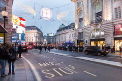 People walking in the Piccadilly Circus and Regent street during Christmas time, London Royalty Free Stock Images