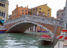 People are walking by the picteresque bridge in Venice, Italy Stock Images