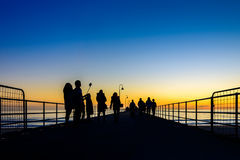 People walking on pier Royalty Free Stock Photos