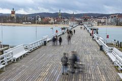 Sopot Pier Molo in the city of Sopot, Poland. People walking on a pier Molo in Sopot city, Poland. Built in 1827 with 511m long it is the longest wooden pier in stock images
