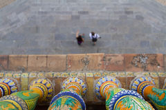 People walking in Plaza de Espana, Seville. Picture taken from an arcade of an historical building Royalty Free Stock Photo