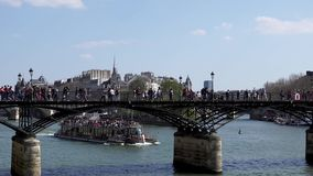 People walking on Pont des Arts bridge on the Seine river - Paris