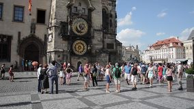 People walking in Prague - Czech. PRAGUE - AUGUST 4: people walking in old town hall or clock tower and The Tyn Church on  background on august 4,2015 in Prague stock video footage