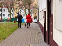 People walking with presents Royalty Free Stock Photo