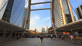 People walking on public sky walk in Bangkok Royalty Free Stock Images