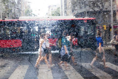 People walking in the rain in the city Stock Image