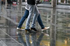 People with walking in rain rush hour Stock Photo