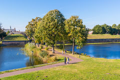People walking and rampart of Naarden, Netherlands Royalty Free Stock Photos