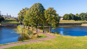 People walking and rampart of Naarden, Netherlands Royalty Free Stock Images