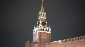 People walking at Red Square Kremlin Moscow city Russia. With Kremlin Chiming clock audio. 7 p.m. stock video