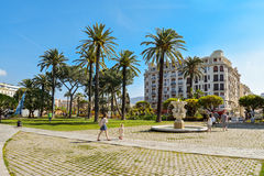 People walking and relaxing in Albert I Gardens Royalty Free Stock Photos