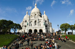 People walking and relaxing in front of Basilique du Sacre Coeur Stock Photography