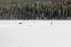 People walking and relaxing in the frozen lake in the alps switzerland in winter Stock Photos