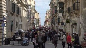 People walking on Republic Street in Valletta Malta. Valletta, Malta – February 17, 2017: Local Maltese people and tourists walking on Republic Street. This stock footage