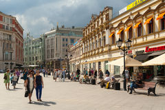 People walking and resting on benches on Kuznetsky Most Street Stock Photos