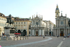 People walking and resting in front of Saint Cristina church Stock Photography
