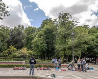 People walking in the Retiro park. Near the top blanket of Madrid with puerta de alcala in the background, is a sunny day. Picture taken in May 2014 Royalty Free Stock Photo