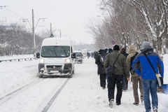 People walking on the road after heavy snowfall. BUCHAREST - FEBRUARY 13 : Heavy snowfall of nearly 60 cm (2 feet) on February 13, 2012 has paralyzed the traffic Royalty Free Stock Image