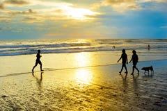 People walking running beach. Bali Stock Image