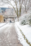 People walking and running by the river in the snow Stock Images