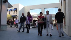 People walking in the shopping center area of Cagnes sur Mer, French Riviera stock video footage