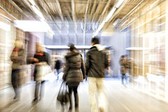 People walking in shopping centre, zoom effect, motion. Group of people walking in shopping centre, zoom effect, motion blur stock image